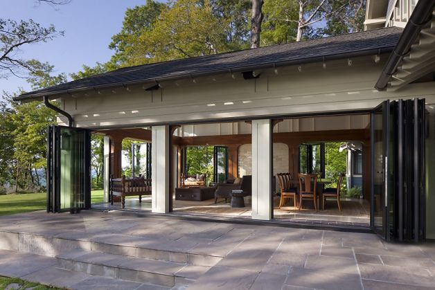 Connect indoor outdoor spaces with folding glass doors for Folding glass wall